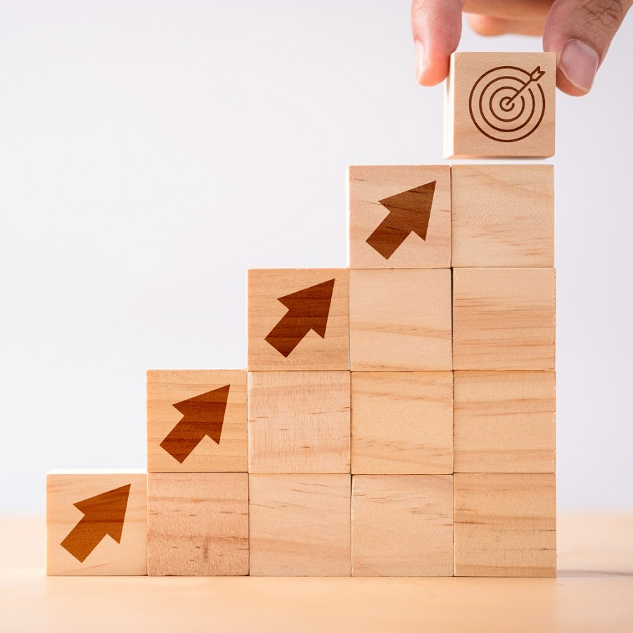 hand-putting-print-screen-dart-and-target-board-wooden-cube-on-up-picture-id1223992751