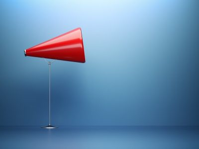 Red Megaphone  In Front Of Blue Wall